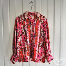 Kukallinen roosavärinen paita